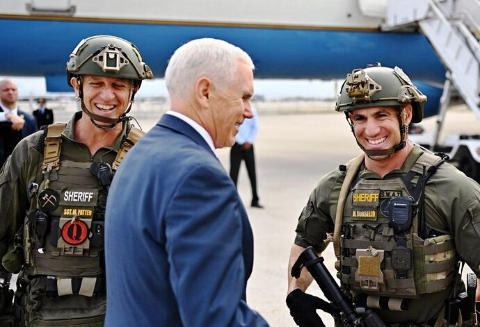 1280px-Pence_posing_with_QAnon_police_crop